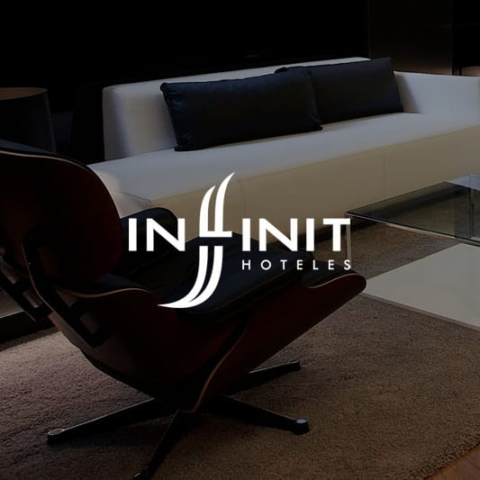 Reception at Inffinit Hotel in Vigo, Spain background image with Inffinit Hoteles Logo in white