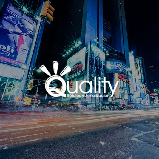 Urban landscape at night, neon lights and traffic background image with Quality Rotulos logo in white