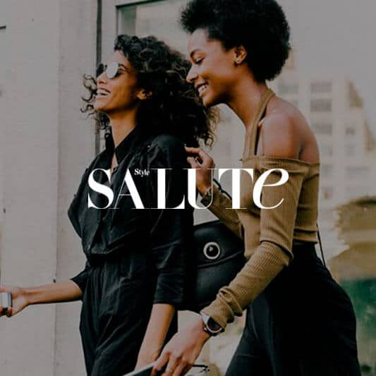 Two stylish balck women laughing background image with Style Salute logo in white