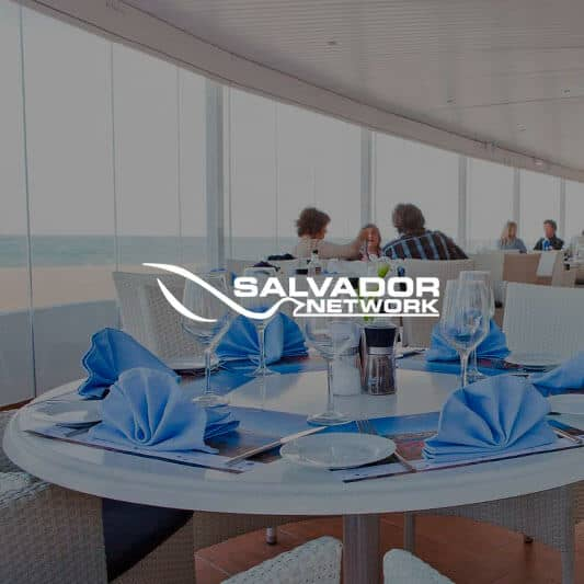 Restaurant and sea views with Salvador Network logo in white