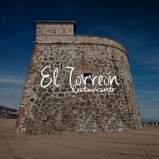 Ancient stone tower in Spain background image with El Torreon logo in white
