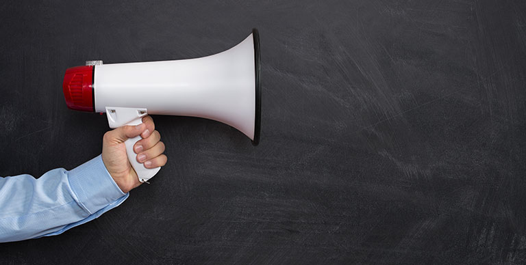 voice speaker holding hand marketing messages promotion