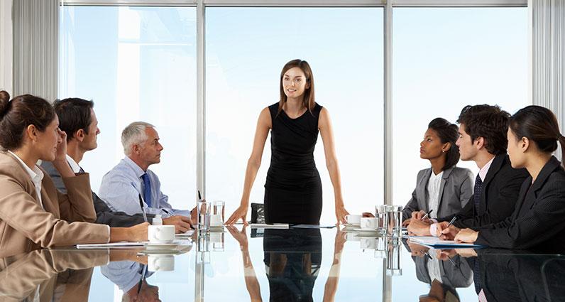 boss woman talking to employees