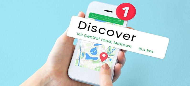 hand holding phone using map