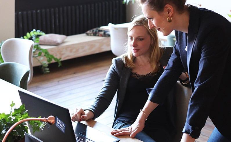 woman boss talking with woman employee