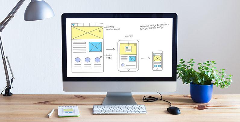 desktop computer designing responsive website