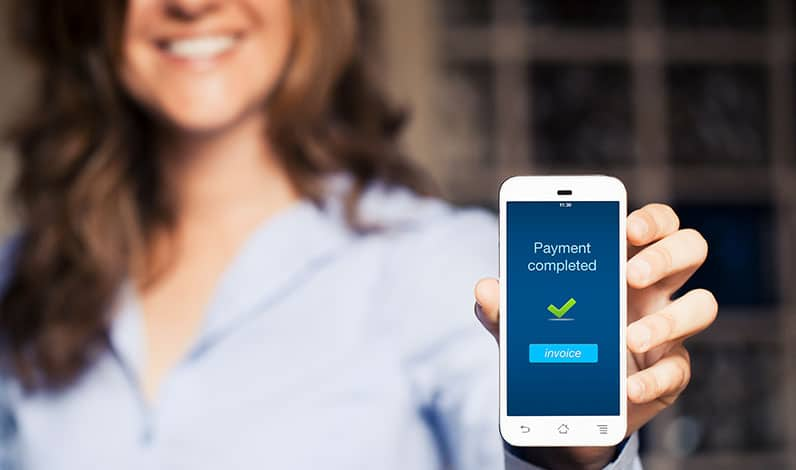 happy woman holding phone payment
