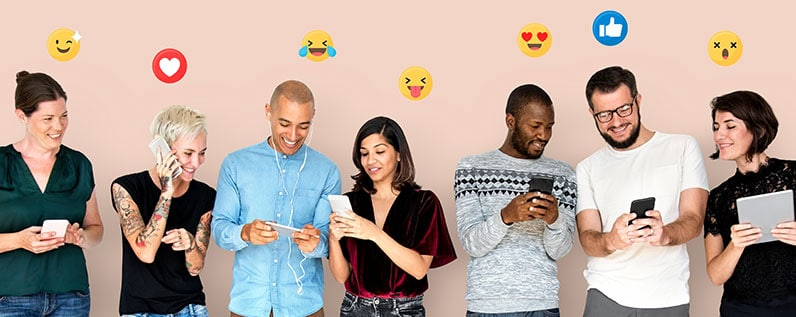 group of people smiling using their phones