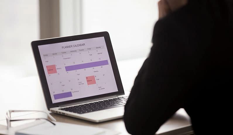 open laptop showing calendar