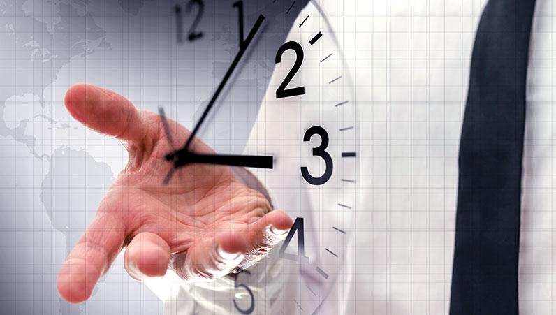 mans hand behind a transparent clock