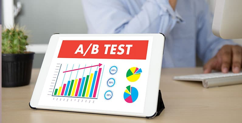 tablet on table showing ab test and man behind