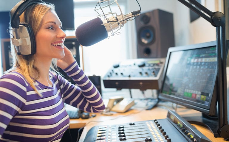 happy woman talking to a microphone