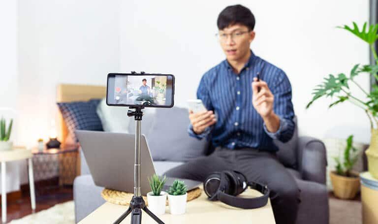asian man recording video