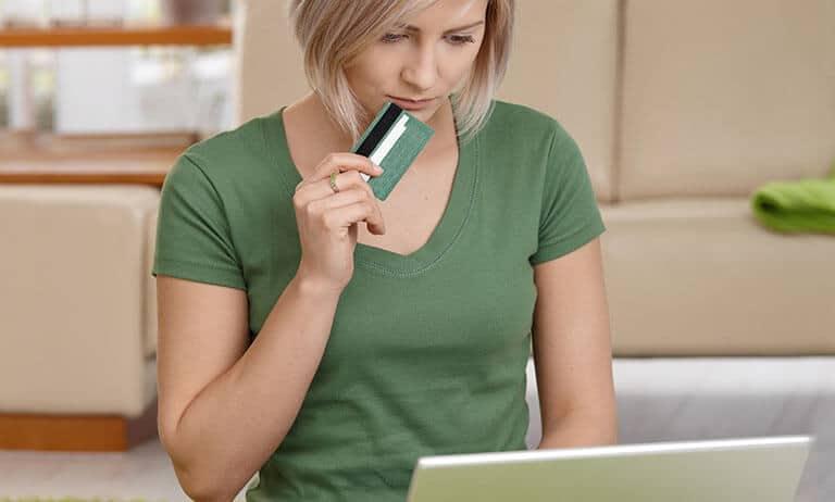 woman think credit card