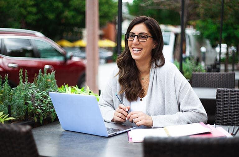 woman working laptop otdoor