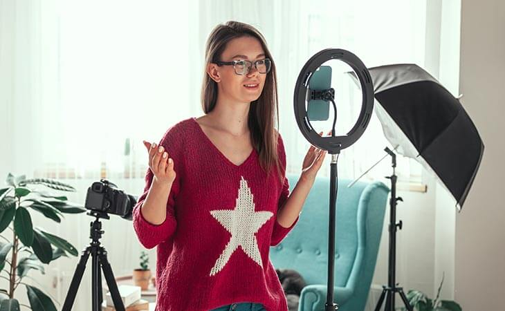 woman influencer recording video