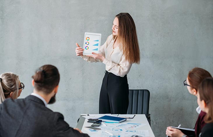 woman showing graphs